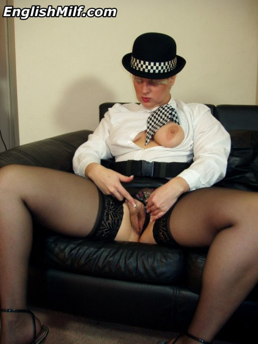 Daniella English wearing stockings & a police uniform showing her cunt